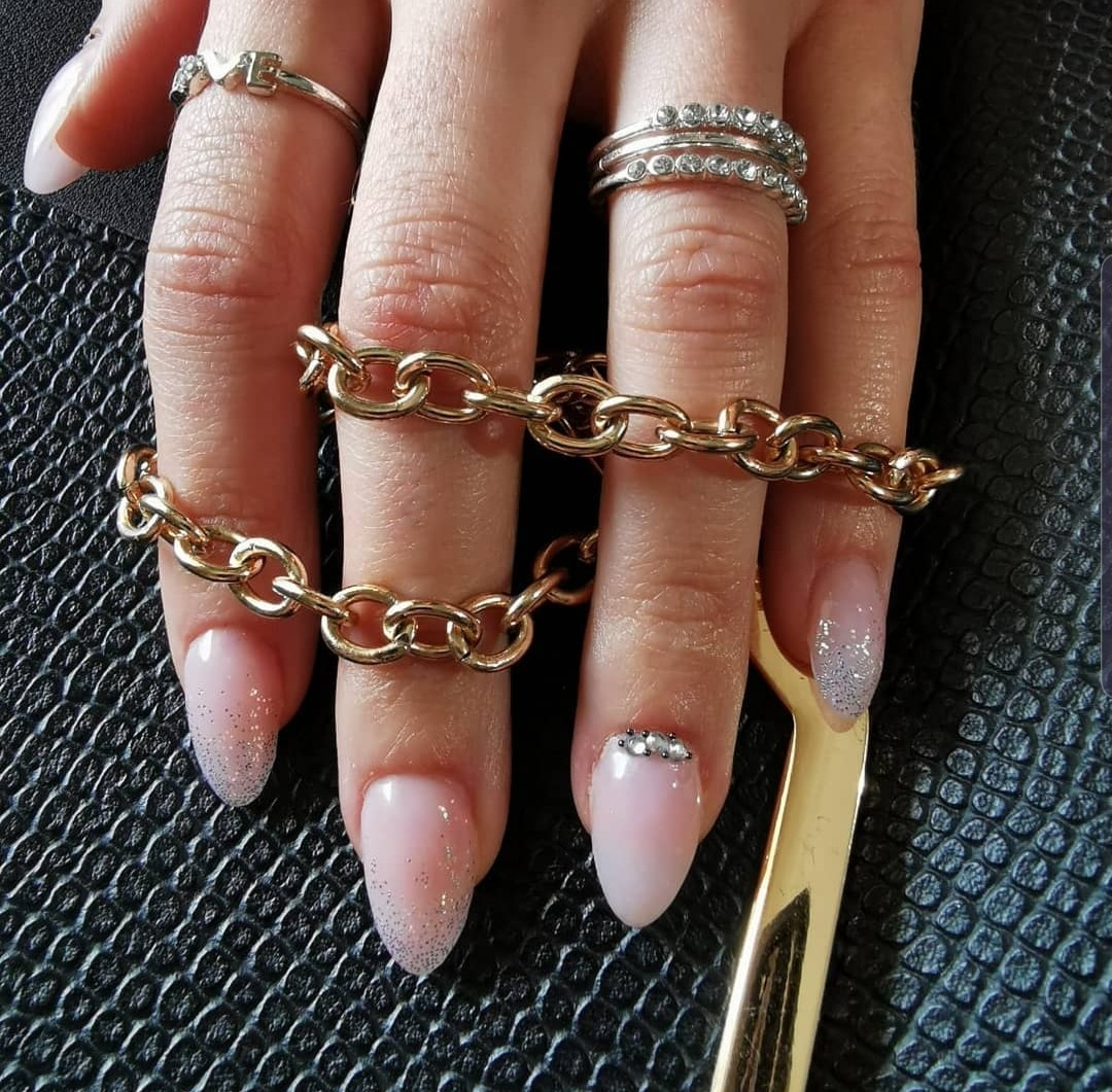 White glittery nails with jewellery